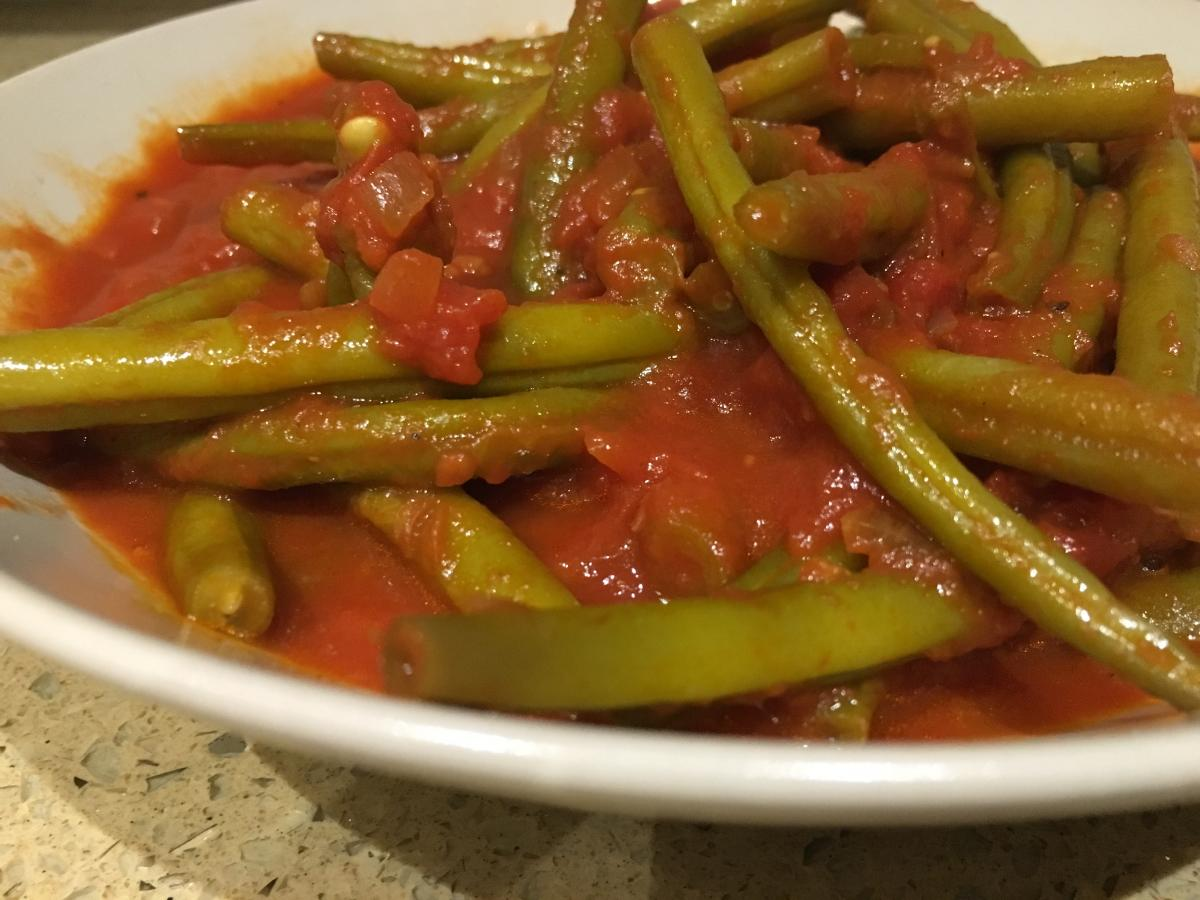 Green beans stewed in a rich tomato sauce
