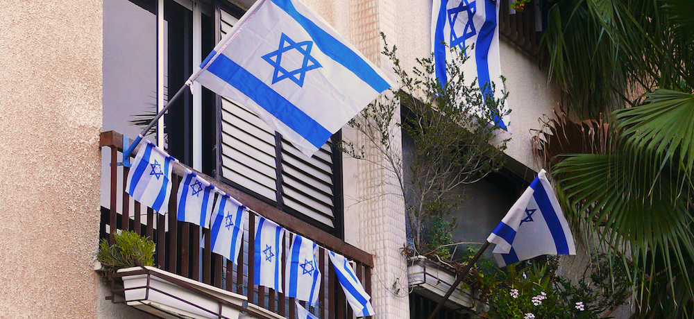 Flags of Israel and little flags decorate houses in Israel for celebrating Yom Ha'atzmaut (Independence Day).