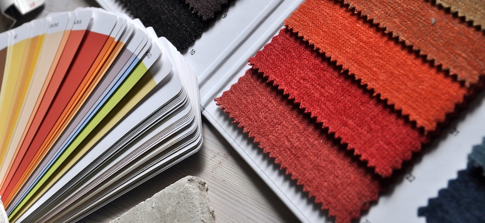A collection of colour fabric swatches and paint samples are paired together.