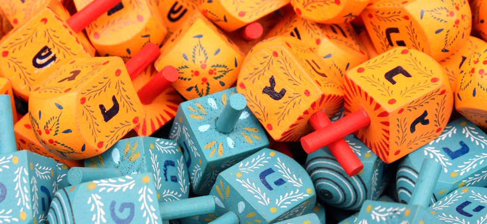 Colourful dreidels for sale in a market.