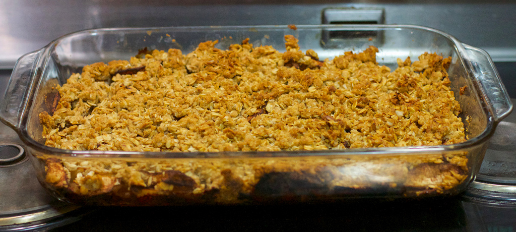 Freshly made apple crumble sits atop the stove.