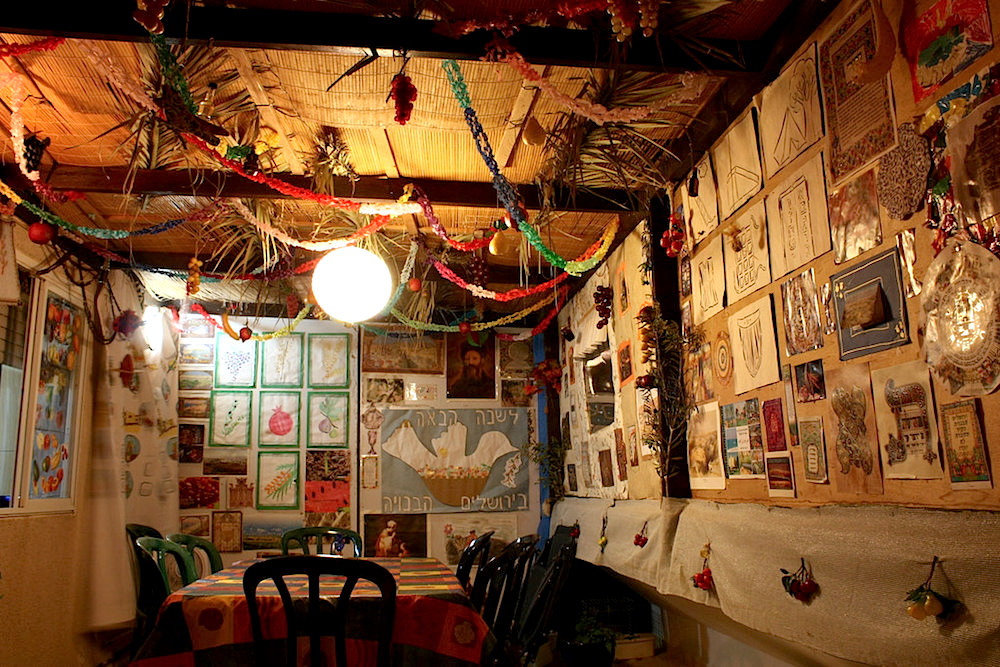 This elaborately decorated Succah has hand drawn pictures all over the walls and paper chains from the ceiling.