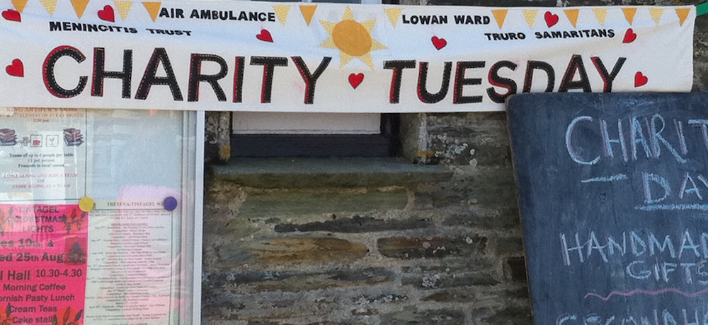 Charity Tuesday banner outside a charity fair.