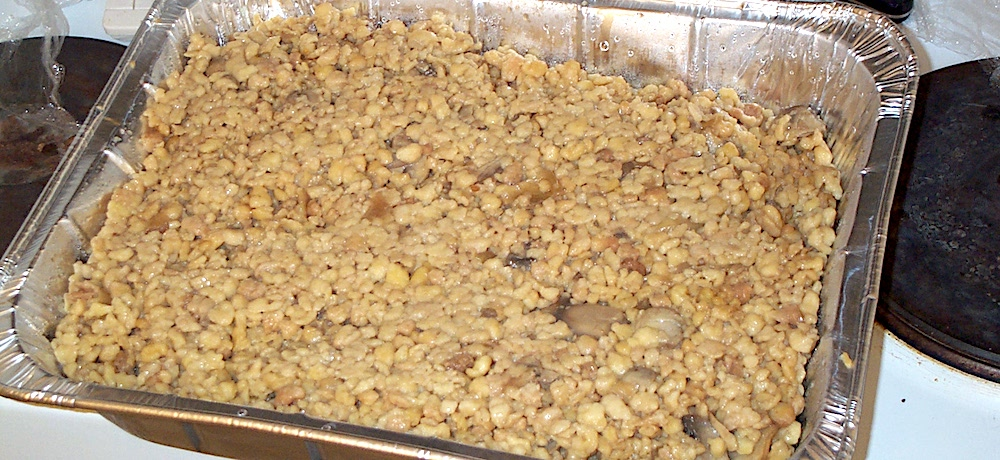 An aluminum tray is filled with homemade farfel.