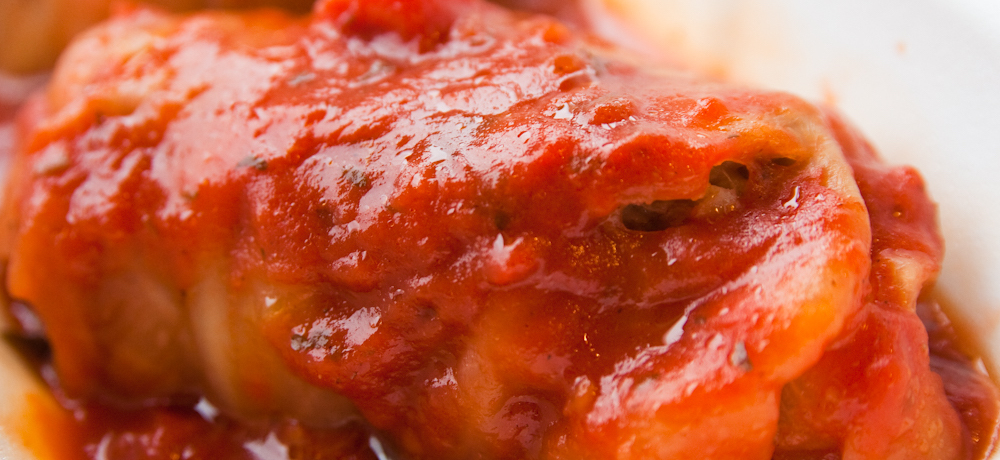Stuffed cabbage topped with tomato sauce.