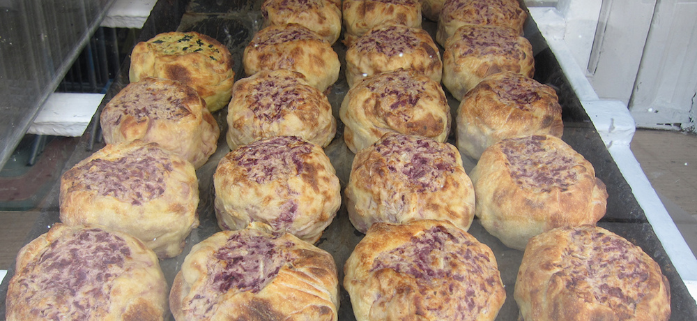 A tray full of beef knishes comes right out of the oven.