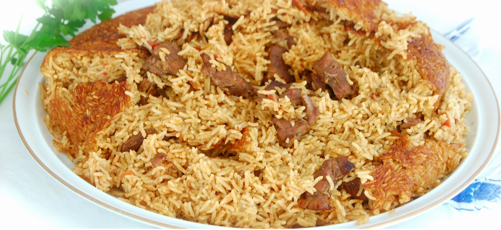Dish of slow cooked rice mixed with cubes of lamb.