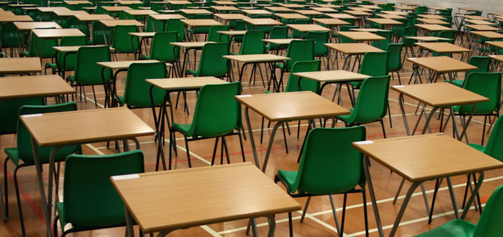 Classroom full of empty desks and chairs.