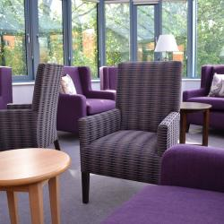 Lobby of a care home shows a comfortable lounge area.
