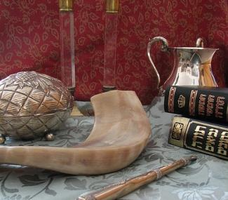 Judaica (clockwise from top): Shabbat candlesticks, handwashing cup, Chumash and Tanakh, Torah pointer, shofar and etrog box.