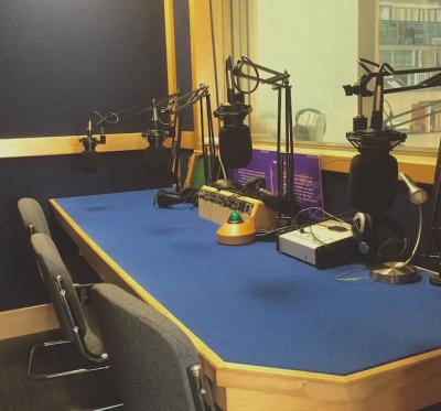 This studio is outfitted with microphones and other equipment suitable for recording purposes.