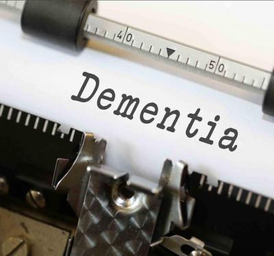 "Typewriter has the word ""dementia"" on a piece of paper."